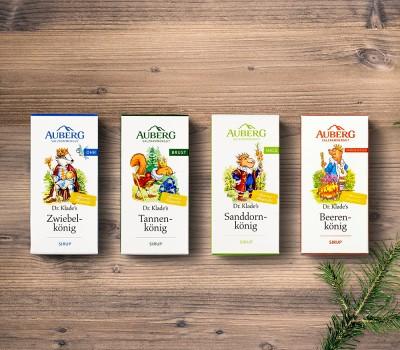 Auberg_Produktcollage_Holzbrett_Produktuebersicht_Sirupe