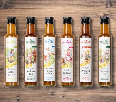 Auberg_Produktcollage_Holzbrett_Produktuebersicht_Teekonzentrate